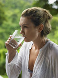Side View Of Woman Drinking Water Royalty Free Stock Image