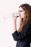 Side view of woman drinking wine. royalty free stock photo