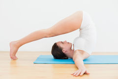 Side view of a woman exercising on mat Stock Photos