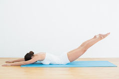 Side view of woman exercising on mat Royalty Free Stock Photography