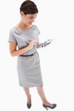 Side view of woman with hand calculator Stock Images