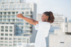 Side view of woman holding glass jar Royalty Free Stock Photos