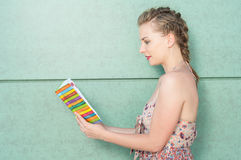 Side view of woman holding opened agenda Stock Image