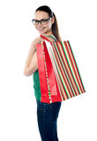 Side view of woman holding shopping bags Stock Photo