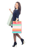Side view of woman holding shopping bags. Against white background Royalty Free Stock Photography