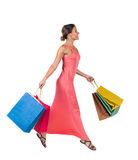 Side view of a woman jumping with shopping bags. Royalty Free Stock Photography