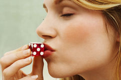 Side View Of Woman Kissing Dice Royalty Free Stock Image