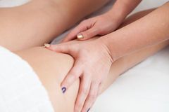 Side view of a woman legs receiving massage therapy stock photos