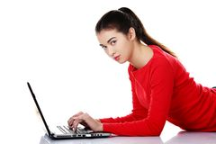 Side view woman lying with laptop Royalty Free Stock Image