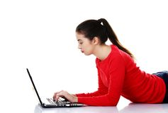 Side view woman lying with laptop Royalty Free Stock Photo