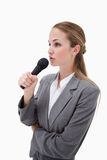 Side view of woman with microphone Royalty Free Stock Photography
