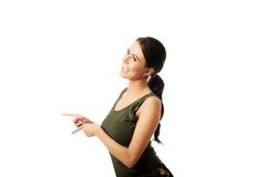 Side view of a woman in military clothes laughing Royalty Free Stock Photography