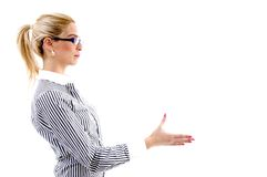 Side view of woman offering handshake Stock Images