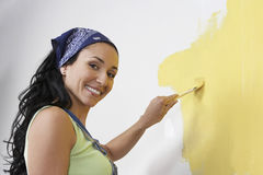 Side view Of A Woman Painting The Wall Yellow Royalty Free Stock Photo