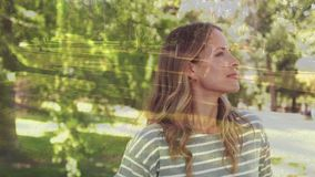Side view of a woman in a park. Side view of a Caucasian woman looking up in a park stock video footage