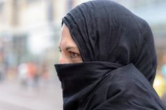 Side view of a woman with ponytail wearing a hijab stock photos