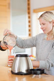 Side view of woman pouring self made smoothie Royalty Free Stock Photography