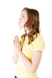 Side view of a woman praying Royalty Free Stock Images