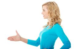 Side view of woman ready to handshake Royalty Free Stock Photo