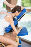 Side view of woman receiving back massage Stock Photography
