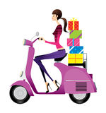 Side view of woman riding scooter Stock Photos