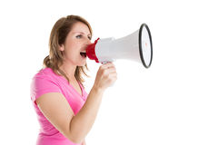 Side view of woman shouting into bullhorn Royalty Free Stock Photos