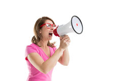 Side view of woman shouting into bullhorn Stock Photos
