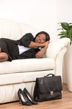 Side View Of Woman Sleeping On Sofa. Royalty Free Stock Photo