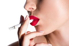 Side view of woman smoking cigarette. Isolated on white stock image
