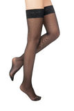 Side view of woman standing in black stockings Royalty Free Stock Image