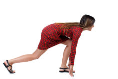 Side view woman start position. Rear view people collection.  backside view of person.  Isolated over white background. The girl in red plaid dress standing Stock Image
