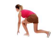 Side view woman start position. Rear view people collection.  backside view of person.  Isolated over white background. Sport blond in brown shorts in the Stock Photos