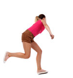 Side view woman start position. Rear view people collection.  backside view of person.  Isolated over white background. Sport blond in brown shorts runs past Stock Image