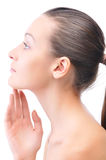 Side view of a woman touching her face Stock Photos