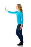 Side view woman touching imaginary screen Stock Photos
