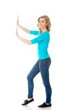 Side view woman touching imaginary screen Royalty Free Stock Images
