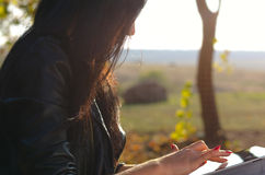 Side view of a woman using a tablet Stock Photos