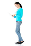 Side view of woman using tablet Royalty Free Stock Images