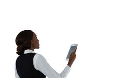 Side view of woman using tablet computer Royalty Free Stock Image
