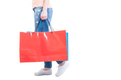 Side view of woman walking and carrying big shopping bags Royalty Free Stock Photos