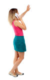 Side view of a woman walking with a mobile phone Royalty Free Stock Photo