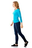 Side view of a woman walking slowly Royalty Free Stock Photo