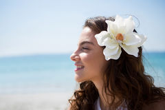 Side view of woman wearing flower Stock Images