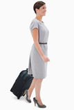 Side view of woman with wheely bag Stock Photography