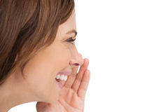 Side view of a woman whispering a secret Stock Image