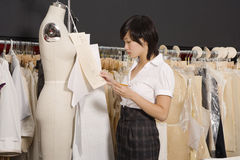 Side view of woman working in her clothing store Royalty Free Stock Photo