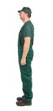Side view. Worker in green overalls. Stock Images