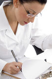 Side view of writing female doctor Royalty Free Stock Image