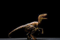 Side view yellow velociraptor toy Stock Photo