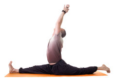 Side view of yoga trainer posing on split Royalty Free Stock Photography